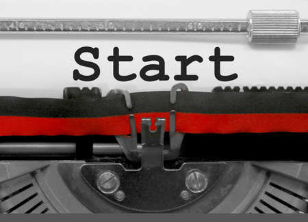 Start  text written by an old typewriter on white sheet Stock Photo