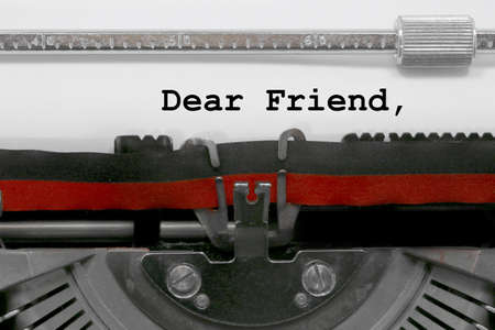 Dear friend text written by an old typewriter on white sheet Stock Photo