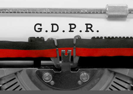 GDPR big text with dot that means General Data Protection Regulation is a regulation in EU law on data protection and privacy for all individuals within the European Union on old typewriter