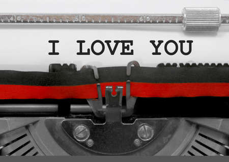 I LOVE YOU text written by an old typewriter on white sheet Stock Photo