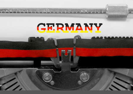 Germany with national colors flag text written by an old typewriter