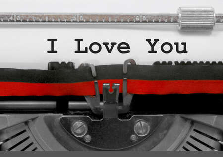 I Love You text written by an old typewriter on white sheet Imagens