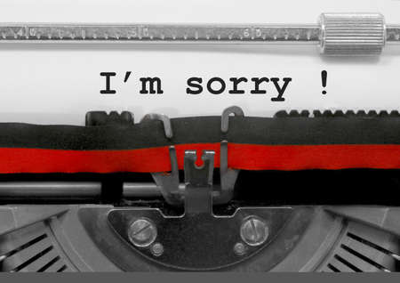 Im sorry text written by an old typewriter on white sheet Stock Photo