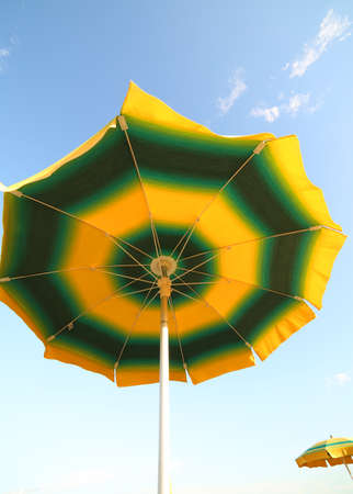 sun umbrella and blue sky in summer bottom view