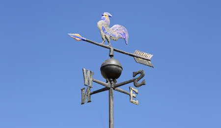 vintage weathervane on blue sky background Imagens