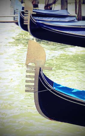 ancient bows of Venice gondolas Stock Photo - 101800953