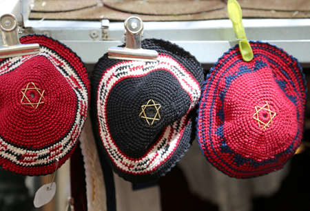 Three Jewish religious headgear called kippahs or yarmulkes with star of David