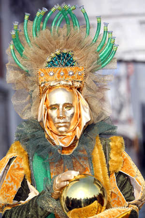 Venice, Italy - February 5, 2018: golden Mask near the bridge of sighs during Carnival Festival Editorial