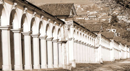 architectural arcades on the uphill road leading at the Basilica dedicated to the Our Lady Saint Mary called in italian Madonna di Monte Berico  in Vicenza  with sepia toned effect