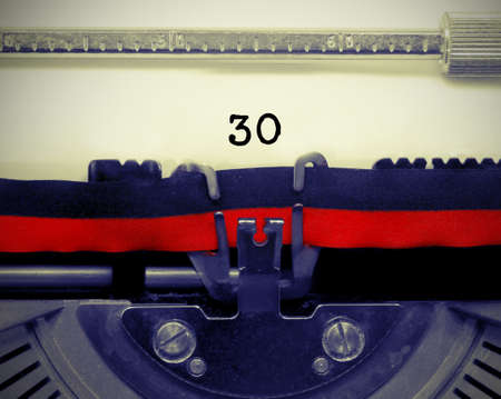 30 Number text written by an old typewriter on white sheet