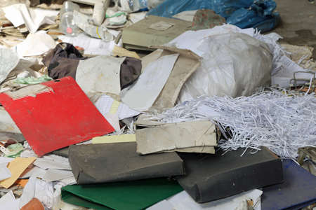pile of wastepaper in an abandoned office with many garbage Stock fotó