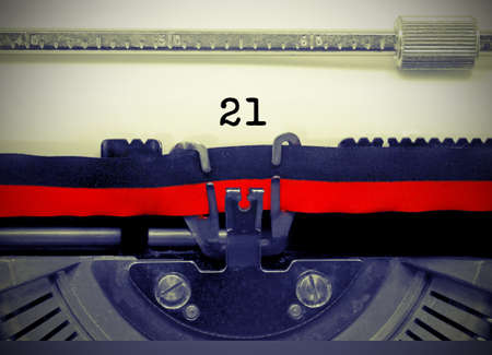 21 Number text written by an old typewriter on white sheet
