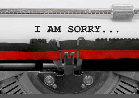 I AM SORRY... text written by an old typewriter on white sheet