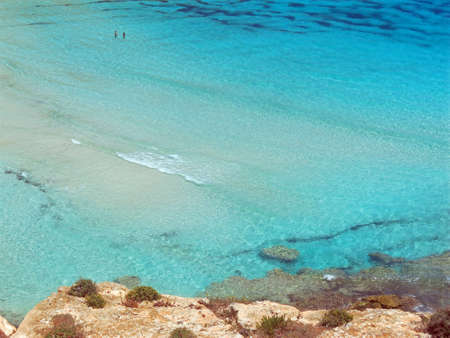 clear water of the Mediterranean Sea that bathes the rocks of the Sicilian coasts