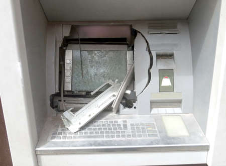 ATM machine with broken glass following a robbery with the use of explosives