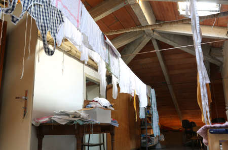 Attic of a kindergarten with a lot of rags and towels to dry after washing