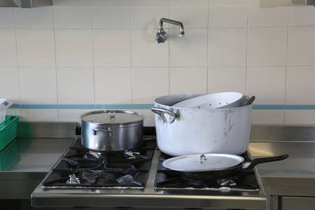 Large industrial cooker of a kitchen of a restaurant with big pots