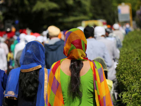 very colorful veil of a Sikh woman during a religious celebration in the street