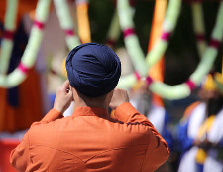 sikh man takes pictures during local festival