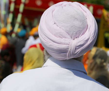 sikh man with turban during the religious rite called Nagar Kirtan
