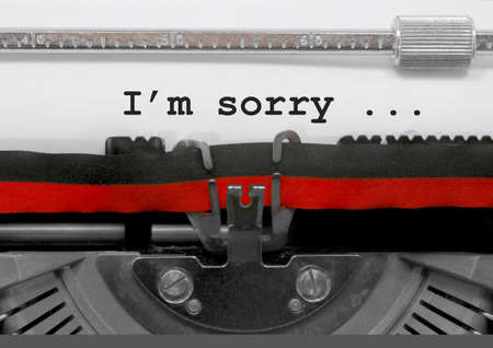 I'm Sorrytext written by an old typewriter on white sheet