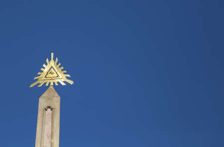 golden Eye of Providence is a symbol with an eye often surrounded by rays of light or a glory and enclosed by a triangle. It represents the eye of God watching over humanity Stock Photo