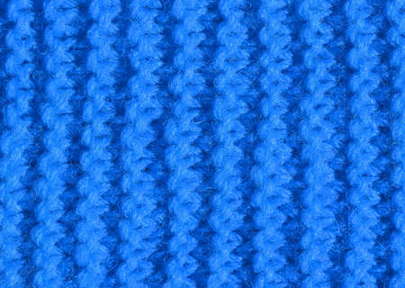 blue background of red wool of a dress made by hand