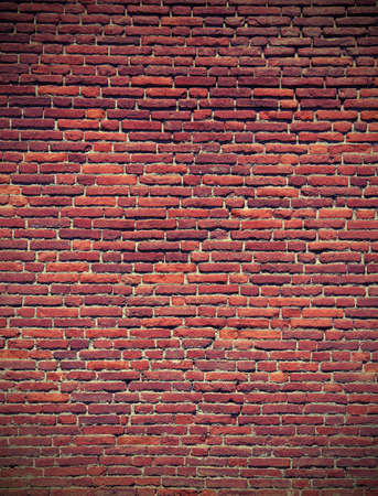 red bricks of an old historic wall with vintage effect Stock Photo