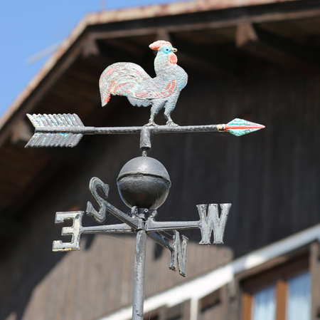 metal vane with a rooster indicating the cardinal points and the wind direction