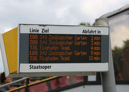 panel with bus schedules and various stops in the European capital