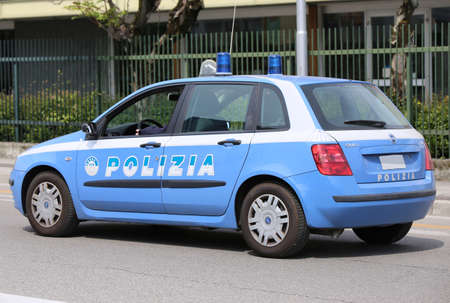 Vicenza, VI, Italy - April 30, 2016: Italian police car during city patrol with big text POLIZIA that means police in Italian language
