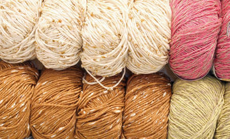 background of wool balls for sale in the knitwear shop