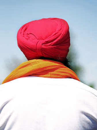 man with beard and red turban and white shirt Stock Photo