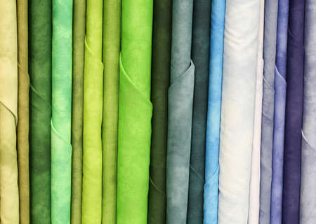 Background of many samples of colorful cotton fabric for sale in the tailor shop