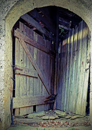 double door of a stable to access two different rooms using a single entrance gate with vintage effect Stock Photo