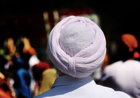 Sikh man with pink turban during the religious rite and high contrast effect Stock fotó