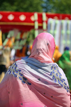 sikh woman with veil during religious rite outdoors