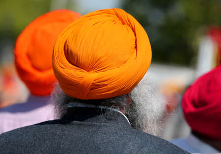 Senior sikh man with white beard and orange turban Stock Photo