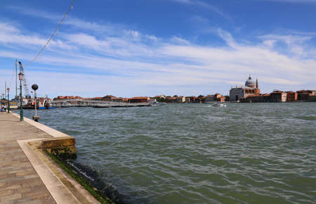 Venice Italy the giudecca Canal and the floating bridge made with boats to go to Redeemer Church called Basilica del Redentore in Italian language
