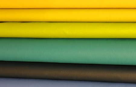 fabrics of various colored fabrics in the artisan tailors shop Фото со стока