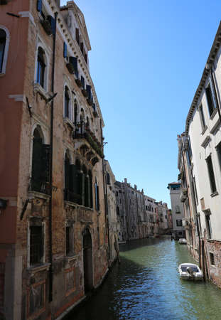 canal with clean water between the houses in Venice in Italy