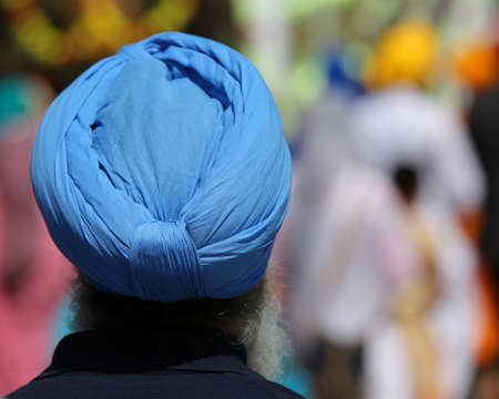 Senior man with blue turban during a religious ceremony