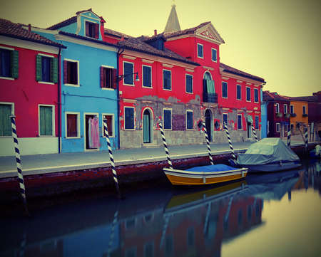 island of Burano near Venice in Italy photographed with the technique of long exposure to give a sense of stillness to water