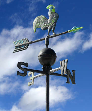 weather vane to indicate the wind direction with blue sky with clouds