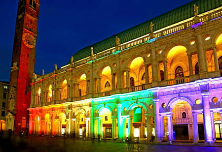 Basilica Palladiana with multi colored lights in the downtown of Vicenza in northern Italy