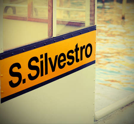 Stop of the ferry  boat called vaporetto in Venice with text S.Silvestro that mean Saint Sylvester with vintage effect Archivio Fotografico