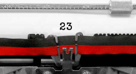 23 Number text written by an old typewriter on white sheet Фото со стока