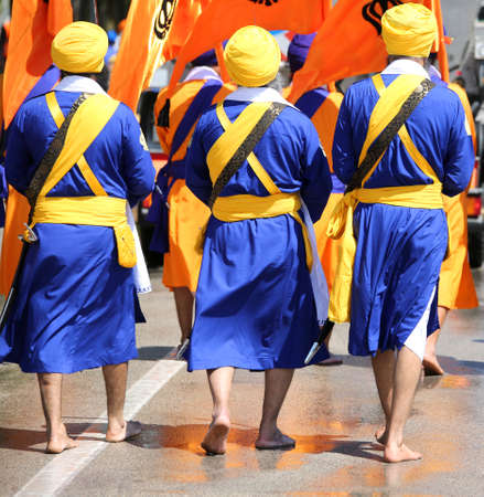 Sikh soldiers in barefoot uniform during a religious celebration Editorial