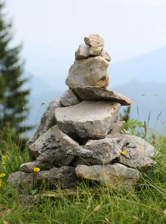 heap of stones called CAIRN or Ometto in Italian Language. This stones are used such as trail markers to indicate the correct path