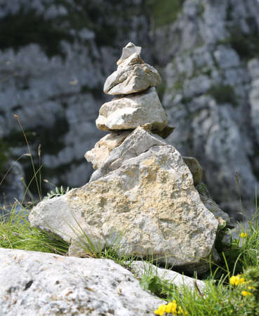 little stack of stones called CAIRN or Ometto in mountain. This stones are used such as trail markers to indicate the right path way
